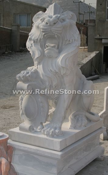 Carved marble lion sculpture